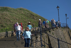 Down the steps at Whitby (Tony Worrall) Tags: yorkshire yorks scene scenery whitby northyorkshire resort whitbyphotos photographsofwhitby yorkshirephotos east eastern seasidetown tourist candid people climb steps stairs up upwards update place location uk england north visit area attraction open stream tour country item greatbritain britain english british gb capture buy stock sell sale outside outdoors caught photo shoot shot picture captured