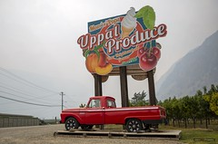 Uppal Produce (Clayton Perry Photoworks) Tags: bc canada explorebc explorecanada summer smoke keremeos old rusty sign uppalproduce red truck mercury