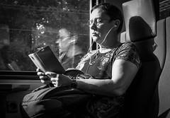 P train lady (Chilanga Cement) Tags: fuji fujix100f fujifilm fujix xseries x100f bw blackandwhite monochrome blackandwhitephoto black candid reading lady commuter train reflection reflections reflecting reflective window windows