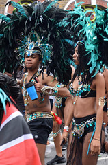 DSC_8348a Notting Hill Caribbean Carnival London Exotic Colourful Black and Turquoise Costume with Ostrich Feather Headdress Girls Dancing Showgirl Performers Aug 27 2018 Stunning Ladies (photographer695) Tags: notting hill caribbean carnival london exotic colourful costume girls dancing showgirl performers aug 27 2018 stunning ladies black turquoise with ostrich feather headdress
