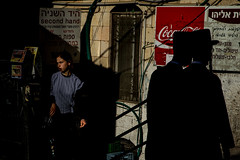 Two Men and a Girl-DSC_0853-2 (thomschphotography3) Tags: jerusalem israel jews jewish ultraorthodox light shadow colours girl men black hats colourful cocacola streetphotography silhouette