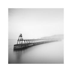 Intervene (Lindi m) Tags: breakwater seamist fog harbour whitby square blackwhite beacon