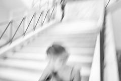 la solitaire (ChrisRSouthland) Tags: stairs person bw blackandwhite blackwhite blur motionblur icm intentionalcameramovement leicammonochrom leicaelmarit28mmf28