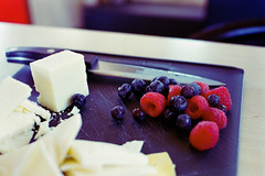 Cheese and Fruit (george.bremer) Tags: 35mm berries c41 cheese color400 cuttingboard film food fpp homeprocessed knife lomography lunch olympus om2n opticfilm120 plustek scan vuescan