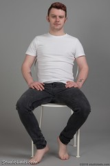 Barefoot guy sitting in jeans (StudioLads.com) Tags: male model man guy dude youth stud hunk pose studio photoshoot chair bulge tight jeans tshirt casual white black hot horny sexy cute foot feet barefoot sit sitting ginger hair