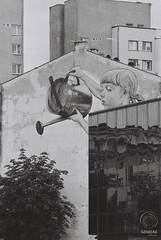 Girl with the watering can (mkarwowski) Tags: białystok streetart mural street canon t70 canont70 rollfilm analog ilford ilforddelta3200 tokina80200mmf45