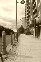 River Aire waterfront, Canary Wharf, Leeds. (dave_attrill) Tags: river aire waterfront walkway canarywharf leeds development west yorkshire westriding september 2018 sepia