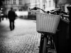 stroll (Sandy...J) Tags: city cobblestones blackwhite bw black white noir urban walking man monochrom bike bicycle fahrrad germany deutschland street streetphotography sw schwarzweis strasenfotografie stadt silhouette blur blurred verschwommen mood stimmung altstadt oldtown olympus