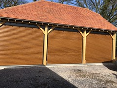 Golden oak SWS Roller Doors inside and out