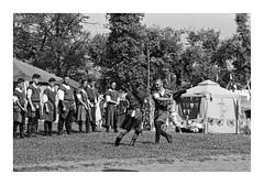 Fight... (lupuszka) Tags: sword swords fight fighting men man grass monochrome blackandwhite bw kodak tmax400 kodaktmax400 tmy praktica mtl5 prakticamtl5 knight knights knighthood tent fort transylvania romania mures
