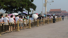 Lineup To See Chairman Mao (peterkelly) Tags: digital canon 6d gadventures transmongolianadventure asia china beijing tiananmensquare lineup queue line crowd visitors chairmanmao maozedong tomb umbrellas umbrella cctv barricade forbiddencity gate
