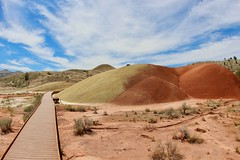 Walking on Painted Cove Trail (daveynin) Tags: voicanic history red boardwalk palette oregon desert