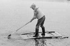 Still afloat (theirhistory) Tags: child kid boy jumper trousers wellies raft water sea oar afloat wellingtons