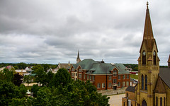 City Hall (Lester Public Library) Tags: tworiverswisconsin tworivers cloudy clouds sky trees buildings communitybuilding church steeple steeples wisconsin downtowntworivers downtown lesterpubliclibrarytworiverswisconsin readdiscoverconnectenrich