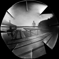 Silhouette on empty table (batuda) Tags: pinhole obscura stenope lochkamera analog analogue paper lid beer beerlid round circular ilford ilfospeed d76 11 9950f landscape nature lake water table bench bridge human silhouette bw blackandwhite summer 2018 uteno ežeras minčiakampis žuviakampis minčia tauragnai utena lithuania lietuva neodymium 8 15