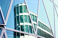 Reflections in Mainhattan (Nathalie_Désirée) Tags: westhafentower frankfurt mainhattan skyline skyscraper house building architecture glass reflection city downtown finance banking economy economist cash money rich schneiderschumacher triangle triangles mirror sky bluesky september window windows fascination fascinating amazing art artistic beautiful canoneos600d canon50mm less lessismore minimalistic outdoor outdoors center centre high tower structure pattern patterns geometry geometric