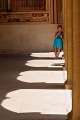 Waiting (Journey CPL) Tags: girl shadow light hallway arch colorful color wait time fashion spanish spain montserrat monastery