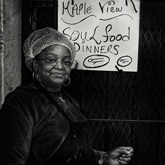 """Though Her Food Was Mostly Savory, She Poured The Sweetness Of Grace Into All Of It She Served"", Martin Luther King Jr. Avenue, Historic Anacostia, Washington, DC (Gerald L. Campbell) Tags: streetphotography street squareformat spirituality spiritualindifference socialdocumentary alienation aloneness blackwhite bw citylife community canonsx60hs dc digital freedom historicanacostia indifference injustice inequality love lunch martinlutherkingjravenue portraitphotography portrait restaurant urbanphotography urban unitedstates washingtondc woman yearning yeswecan"
