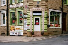 Marhaba (Peter.Bartlett) Tags: minoltax700 fastfood shopfront portra400 corner doorway film peterbartlett doubleyellowlines urban steps westyorkshire unitedkingdom shopwindow menu kirklees huddersfield sign facade kodak england gb