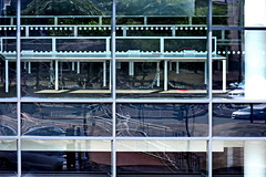 inside outside (Harry Halibut) Tags: 2018©andrewpettigrew allrightsreserved imagesofsheffield images sheffieldarchitecture sheffieldbuildings colourbysoftwarelaziness sheffield south yorkshire sheff1808189043 window reflections tables desks circlescirclescircles 0ffices commercial street