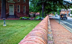 Summer in Colonial Williamsburg (Paul McCarthy99) Tags: 7dwfsummer 24mmf28 minolta colonialwilliamsburg bricks wall bokeh sony a6000 street summer