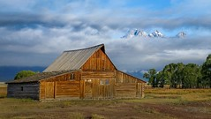 Peaking Through (www.yabberdab.com) Tags: barn mormonrow grandteton nationalpark usa mountain