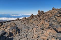 Rocks on the Pico del Teide (Tambako the Jaguar) Tags: mount teide pico top mountain volcano desert rocks stones sky clouds nationalpark nature landscape scenery view tenerife spain nikon d850