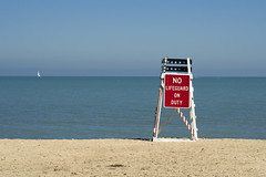 No Life Guard (DJ Wolfman) Tags: lakemichigan evanston illinois lifeguard blue red white yellow sand beach sailboats water calm