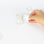 Woman playing with puzzles thumbnail