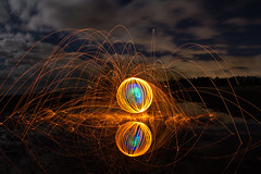 Fire Orb at Island View Beach (vanessa_macdonald) Tags: blue orb orbs fireorb firespinning fireworks pyrotechnics pyrotechnical pyro fire fireartistry steelwool steelwoolspinning burn burning night photography nightphotography reflections reflection water tide fullmoon