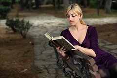 reading in the park 2 (dim.pagiantzas | photography) Tags: people woman women female face portrait hair blonde park nature trees plants road light ambient spot bokeh canon colors colorfull book reading pages
