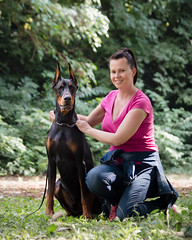 Burgus & master's portrait (zola.kovacsh) Tags: outdoor animal pet dog show exhibition dobermann doberman pinscher wood green forest
