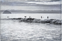 Waiting for the Perfect Wave (lorinleecary) Tags: california cayucos morrorock sigma60mm beachscenes textured beachscapes photomorphisbites surfers blackandwhite monochrome digitalart
