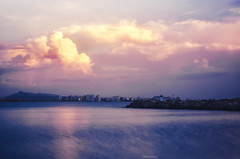 Lugubre...!!! (Nita_Fotos) Tags: sun sundown clouds blue orange sol atardecer nubes naranja cielo mountain montañas reflection reflejos trees arboles agua backligh contraluz longexposure llargaexposicion marcaribe caribbeansea sea ciudad city lecheria venezuela tuniñasalvajedelaselva