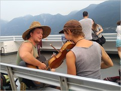 Bowen Island Ferry Music BC18h21 LG (CanadaGood) Tags: canada bc britishcolumbia bowenisland bcferries ferry sea howesound people person music violin mountain canadagood 2018 thisdecade color colour cameraphone sign guitar