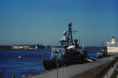 Riga, April 2018 (rixo.hmnby) Tags: 35mm film filmlove analog travel tourism riga latvia visitlatvia colour toned grain architecture style sights sky blue red city cityscape urban war military ship battleship river