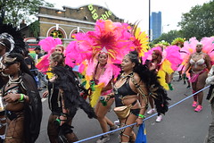 DSC_7586 Notting Hill Caribbean Carnival London Exotic Colourful Costume Pink and Yellow Ostrich Feather Headdress Girls Dancing Showgirl Performers Aug 27 2018 Stunning Ladies (photographer695) Tags: notting hill caribbean carnival london exotic colourful costume girls dancing showgirl performers aug 27 2018 stunning ladies pink yellow ostrich feather headdress