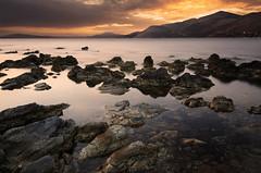 Fanari Beach - Kefalonia (zdenisaba) Tags: kefalonia beach mountain water sea rocks shallow sunset horizont clouds
