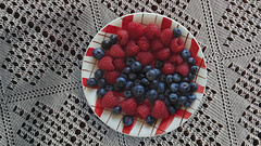 Raspberries and blueberries (Dragan*) Tags: raspberry blueberry fruit food plate tablecloth pattern crochet indoor malina borovnica