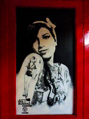 A Portrait of Amy Winehouse (Steve Taylor (Photography)) Tags: amywinehouse tattoo tshirt thedublincastle pub door portrait picture streetart mural graffiti black red white glass woman uk england london camden gb greatbritain shiny