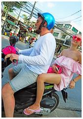 Ready to Zoom Away - Phuket, Thailand (TravelsWithDan) Tags: youngcouple motorcycle riders phuket thailand city urban streetportrait canong3x prettywoman dressedinpink backofamotorcycle