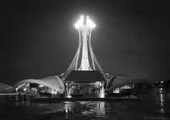 Wet Olympic Stadium Montreal (Fabian_Aldazabal) Tags: stadium olympic stade olympique montreal quebec canada 1976 wet structure rain thunderstorm clouds cloudy night lights reflections water fountains contrast motion o bw black white park architecture design composition reflection mood puddles framing