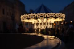 Ilusiones de la Infancia... (protsalke) Tags: infancia recuerdos street urban city chilhood illusions bokeh lights luces memories carrousel dreams sevilla momentos juegos nikkorais50mm12 ilusiones tiovivo