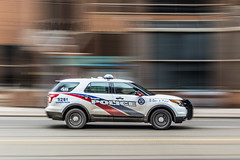 Hot pursuit... (HisPhotographs.com) Tags: toronto police car suv ford explorer panning action fast motion moving downtown city blur 40mm prime