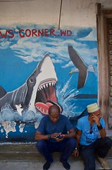IMGP5398 Don't text, is dangerous ! (Claudio e Lucia Images around the world) Tags: stonetownzanzibar tanzania pentax pentaxk30 pentax18135 pentaxart africageographic texting shark sharkattack people sitting text
