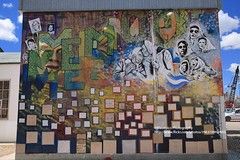 Puerto Madryn, history and art (blauepics) Tags: argentina argentinien patagonia patagonien chubut province provinz provincia clouds wolken scenery puerto madryn harbour port hafen tones farbtöne colours farben houses häuser building gebäude wall wand history geschichte art kunst