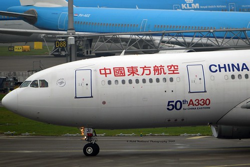 """China Eastern Airlines B-8231 Airbus A330-243 cn/1664 Sticker """"50th A330 for China Eastern"""" 09-2015 @ EHAM / AMS 08-11-2017"""