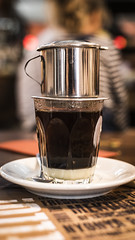 THIS is how you do coffee! (Reckless Times) Tags: vietnam vietnamese coffee perculater milk black white treat cafe viet noung nikon banan tree bananatree dof meal family d750 project 100x oxford 50mm