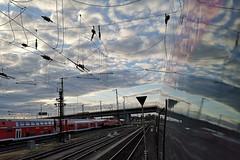Wolken, Leitungen und Gleise... (gatierf) Tags: himmel wolken gleise zug nahverkehr spiegelungen
