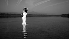 so far away (OneLifeOnEarth) Tags: seeley lake montana mountain water 4396 4pm self portrait white dress bw canon reflection